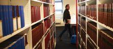 Man walking through a library