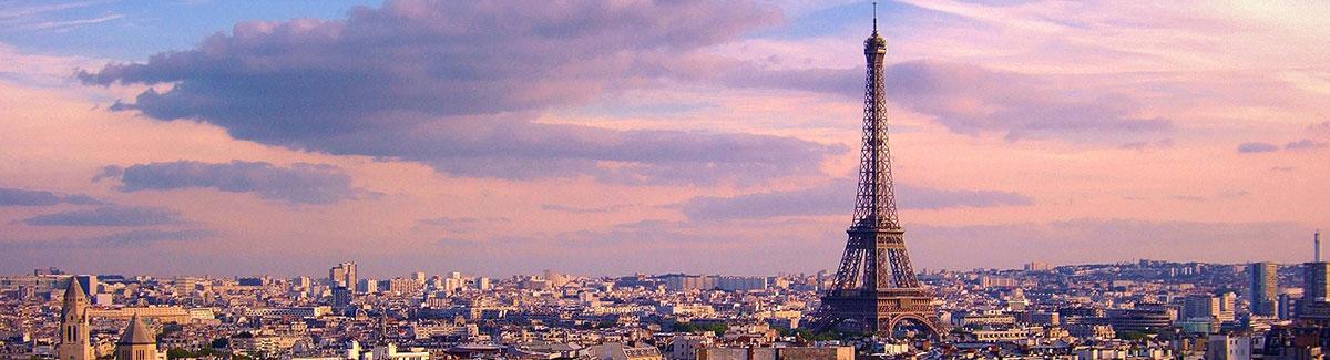 The Eiffel Tower and Paris skyline at dusk