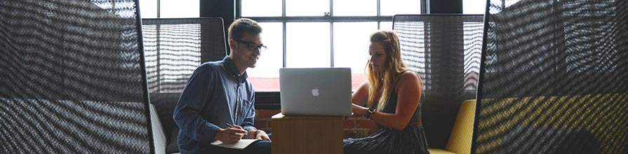 Two people in office working