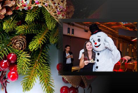Christmas decorations and alumni at City Alumni Christmas Party