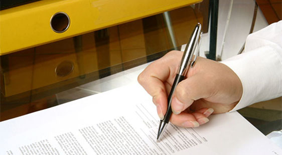 A man signing a document