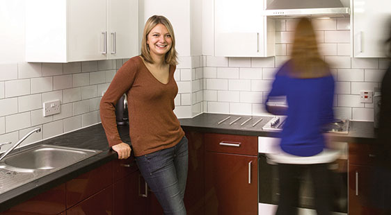 Two female students in a halls kitchen