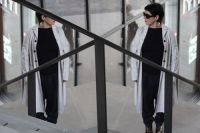 Lore Lixenberg: woman walks up some steps and is reflected in part of the image