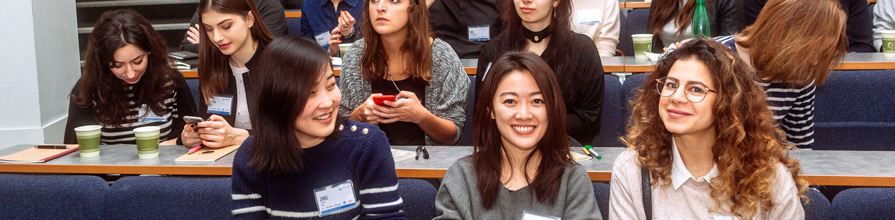Three young women in the audience at the World Information Architecture day event at City