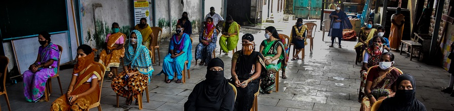 Women in Dharavi waiting to receive food and sanitation kits in July 2020.