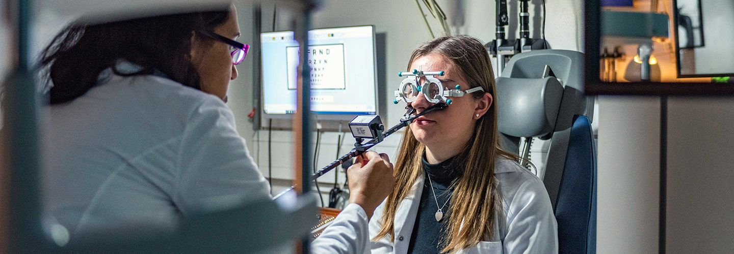 Student checking female students vision in Optometry lab