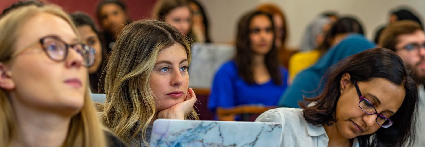 Undergraduate students listening in lecture