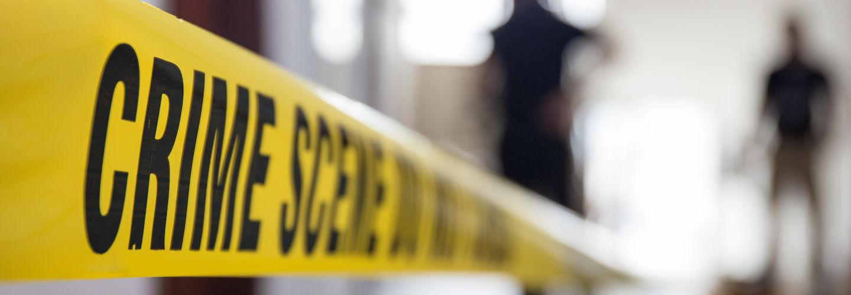 Crime scene tape in building