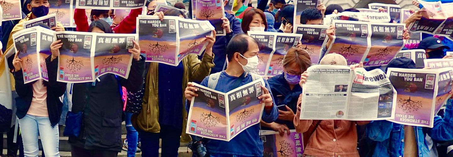 Hongkongers queue to buy a copy of the last-ever edition of Apple Daily