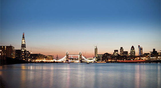 The Lodon skyline at night, including the Shard, River Thames, Tower Bridge and the Gherkin
