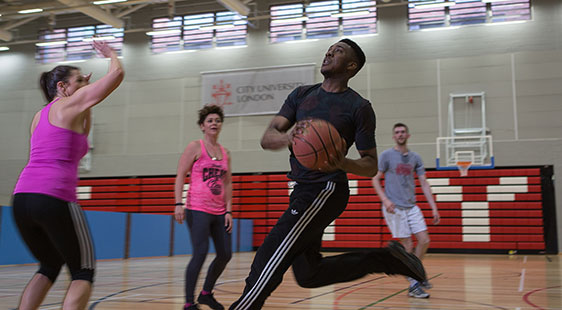 A group of City students playing basketball at CitySport