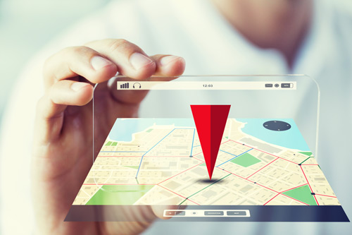 A red triangle pointing to a place on a phone's map