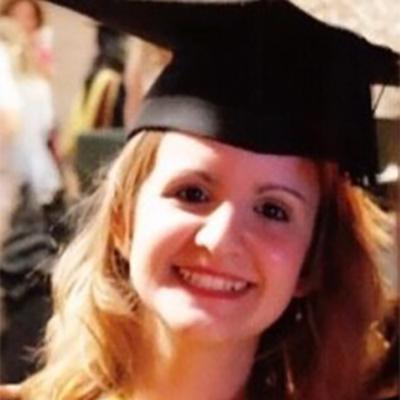 Lucia Macchia smiling in graduation attire