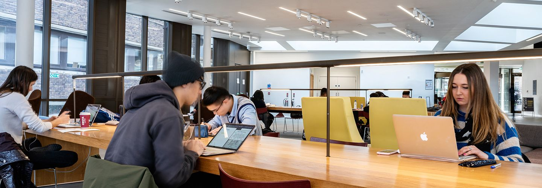 Students using laptops the pavilion study area