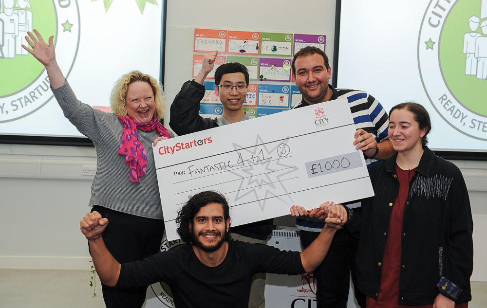 Fantastic 4 + 1 team holding their CityStarters cheque presented by Caroline Wilson