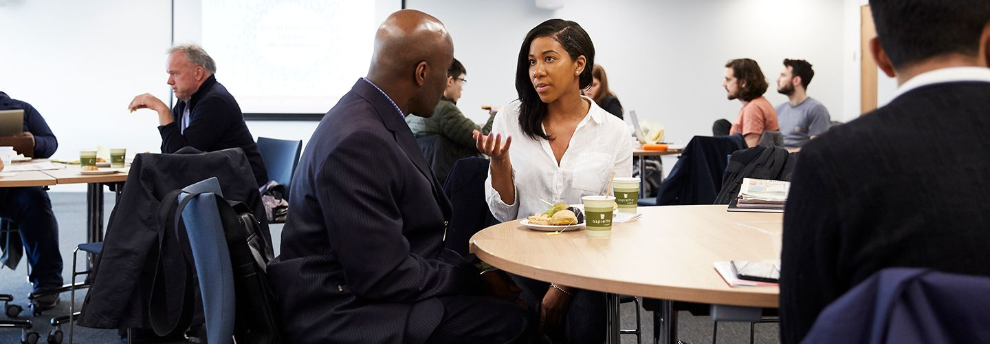 Female entrepreneurship talking to a man in a business workshop