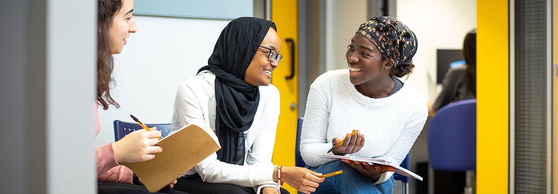 Three female students smiling