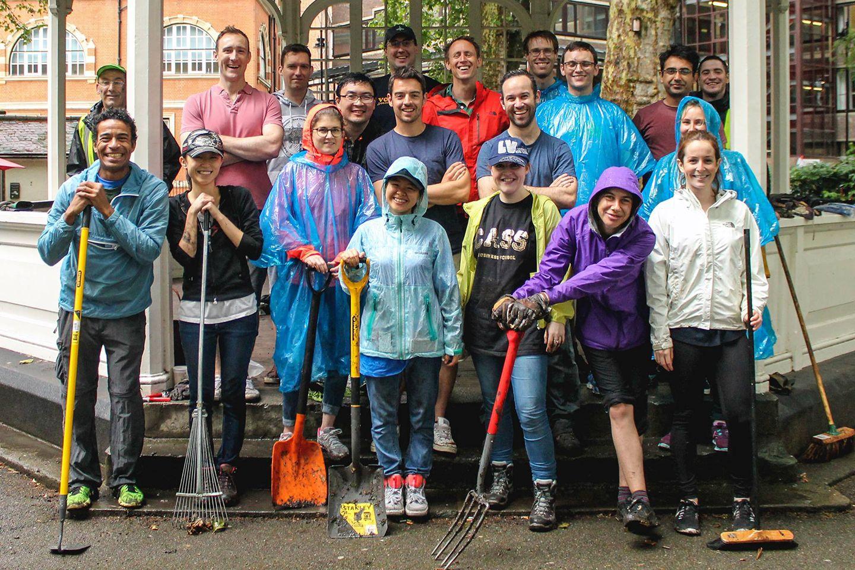 Volunteers doing gardening standing together