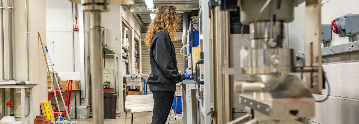 Female student working on a project in the engineering lab