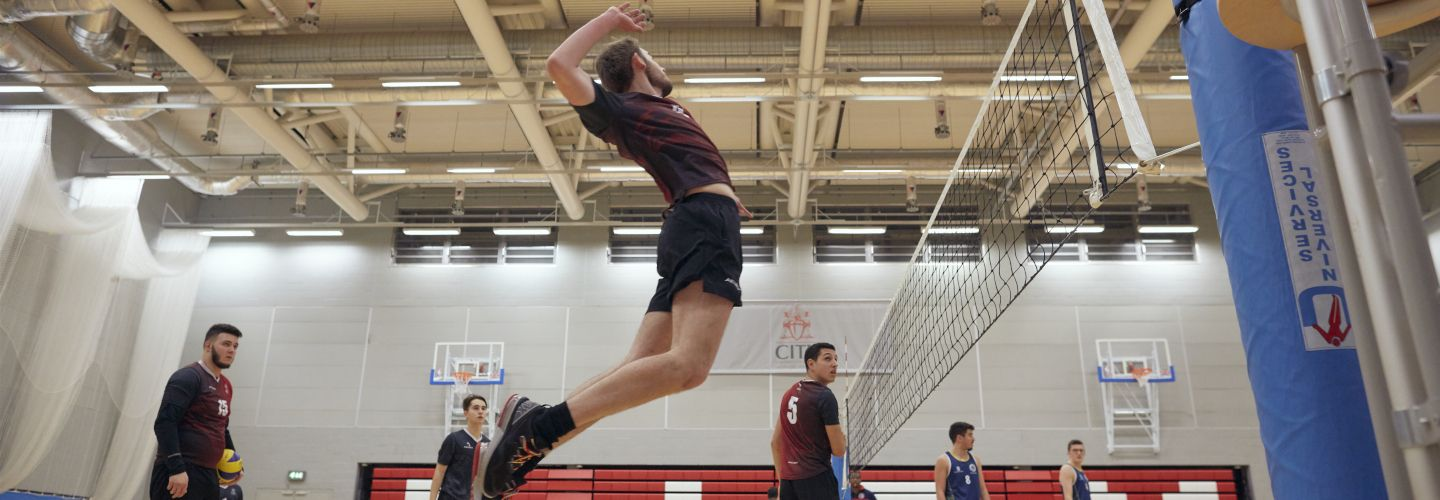 Action shot from a City VS Brunel men's volleyball match