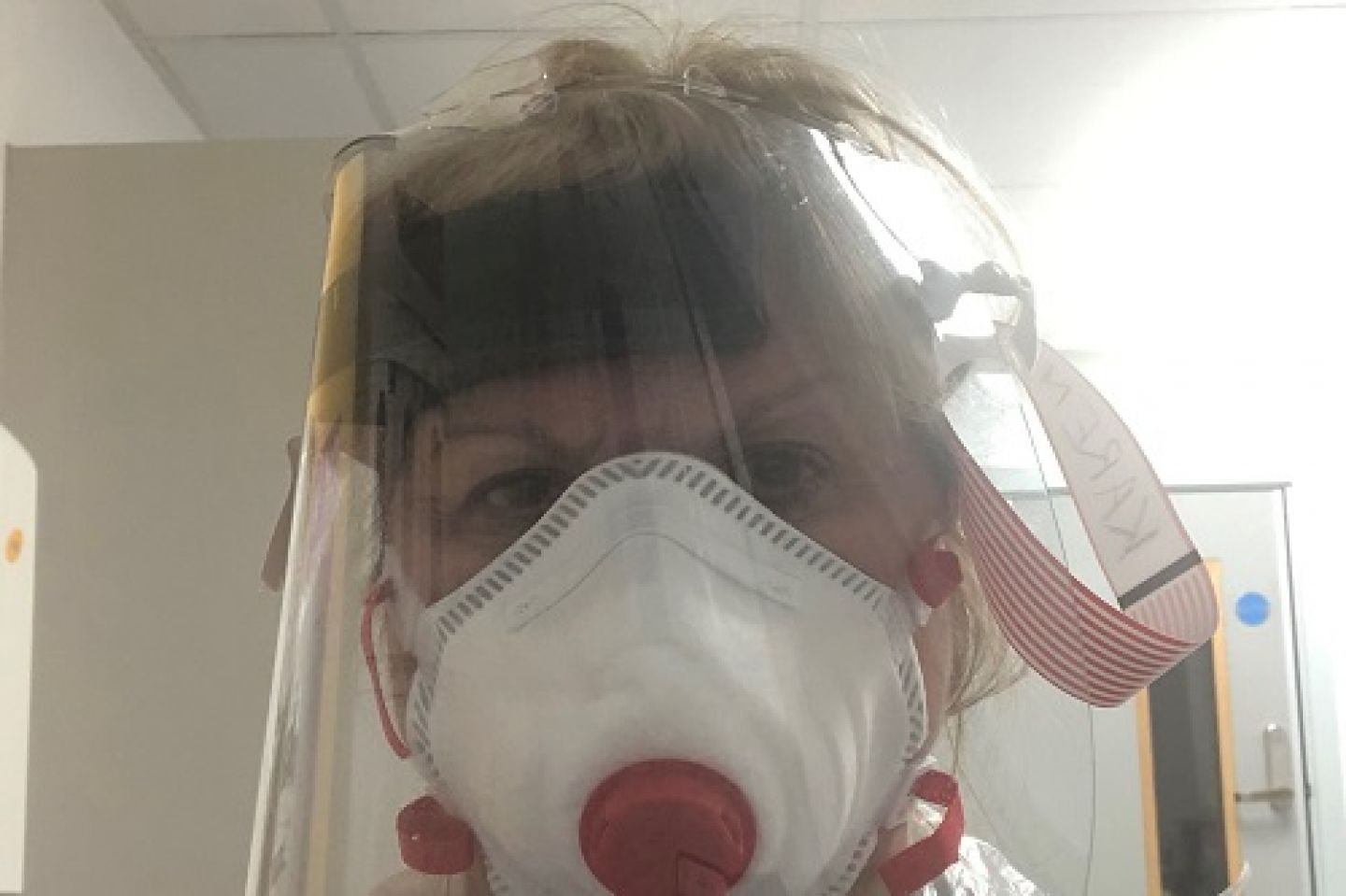 Karen Chandler, Lead of Division of Nursing at City, University of London, wearing PPE (Personal Protective Equipment)