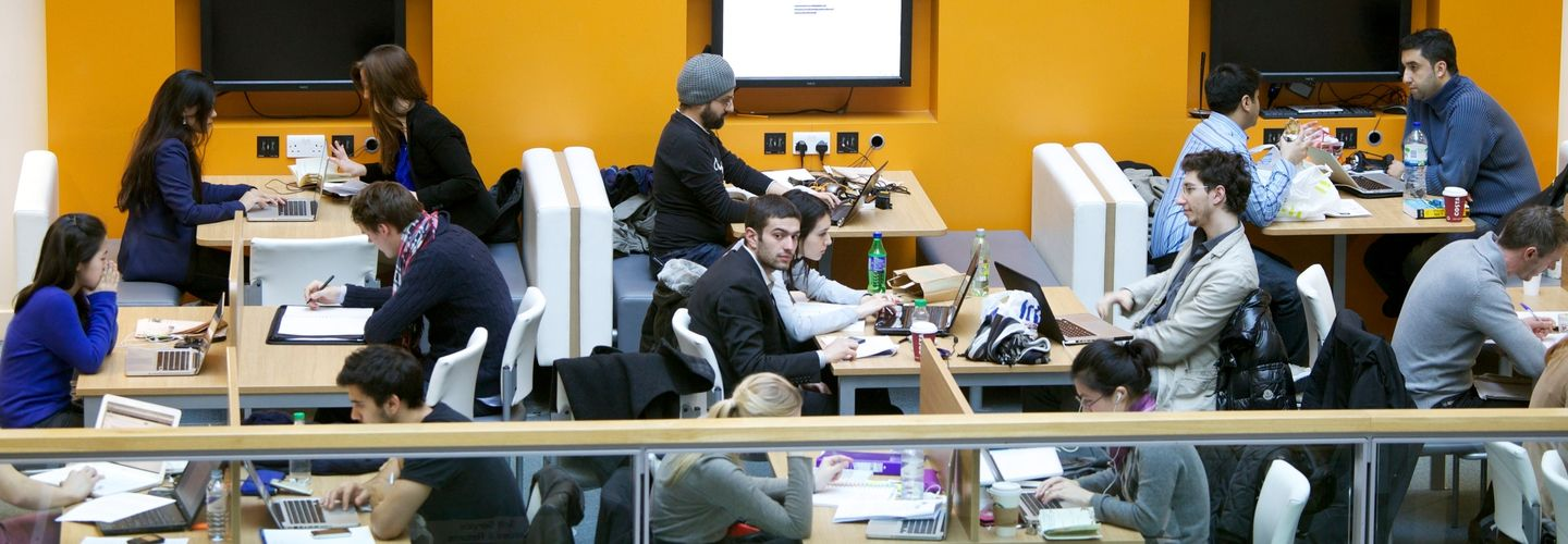 Students working on laptops in a study space at Bunhill Row.