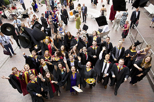 Students-hat-throw-City-Uni-London-graduation-July-2013