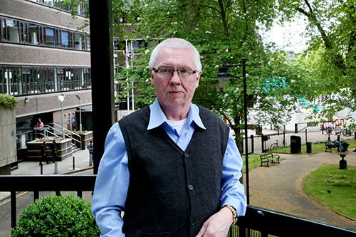 Martin Deal in glasses standing in front of Northampton Square gardens