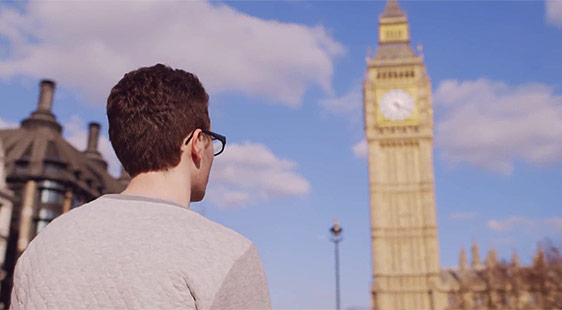 A student looks up at Big Ben