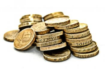 A heap of British pound coins