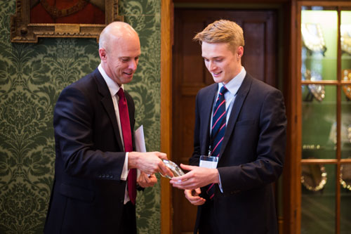 Tom Phillips revieves his Future Legal Mind award from Simon Trott chair of the judging panel