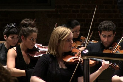 5 people playing the violin