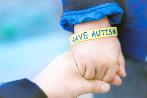 Awareness Picture-I have Autism -Autism Mom holding hand her Autistic Child