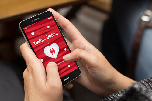 Woman using an online dating app on a smart phone