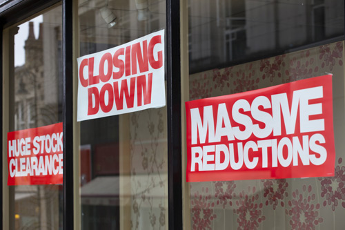 Closing down signs on shop window