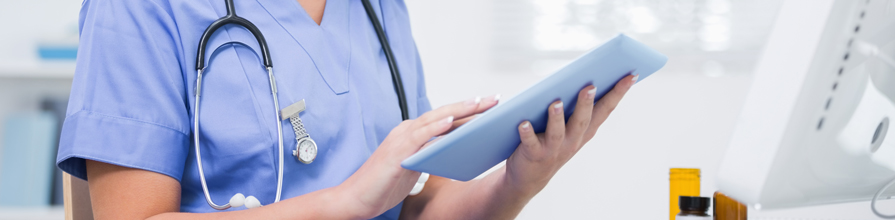 Young female doctor using iPad