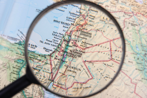Magnifying glass on Palestine Map