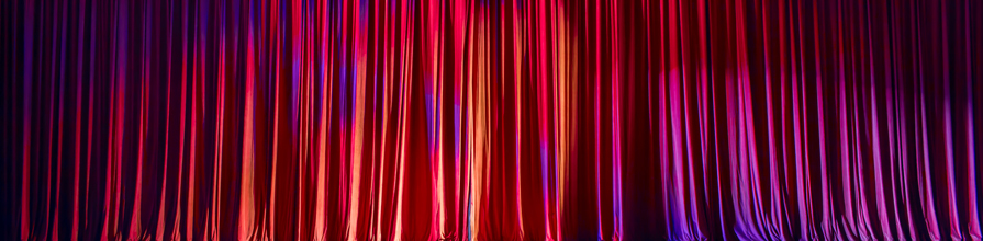 red curtains drawn on stage