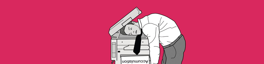 Man in despair with head on photocopier