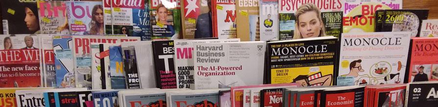 Leading consumer magazines on a shelf