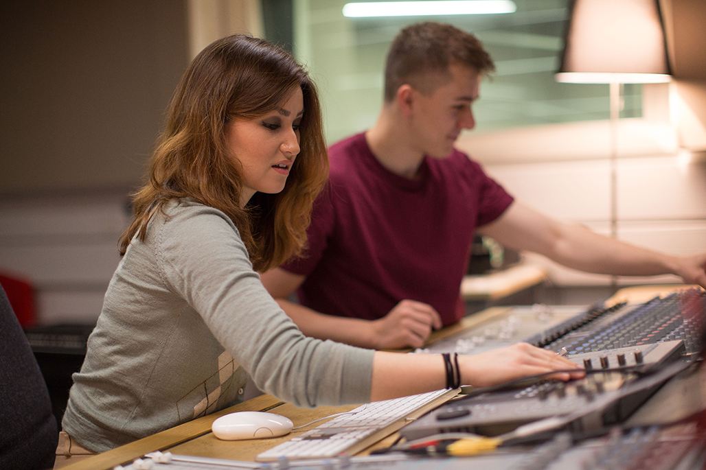 Two students using the radio studios
