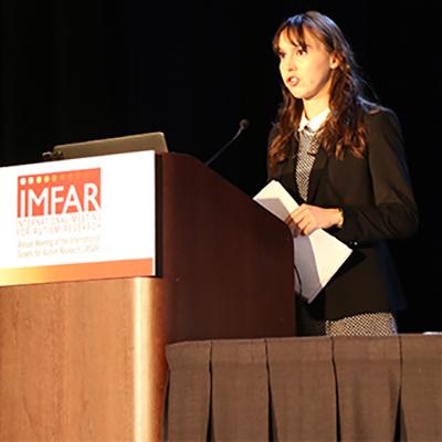 Sara Pisani speaking at a podium