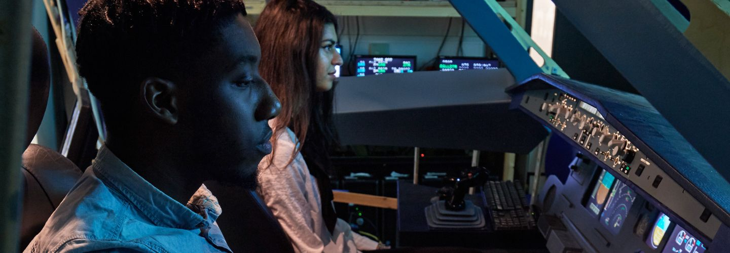 Two students in a flight simulator