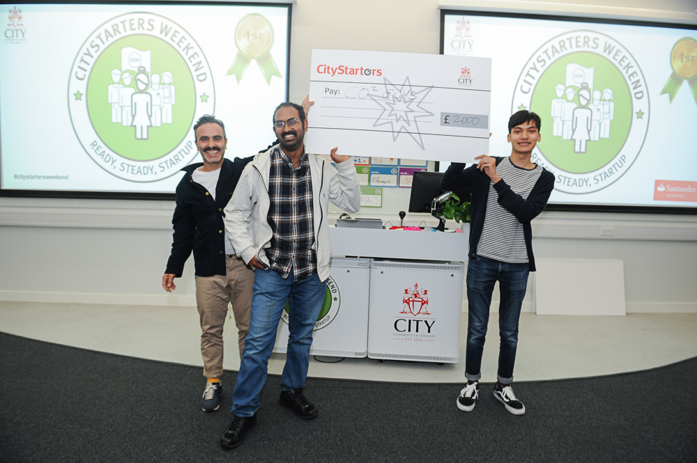 CO2 Guys team holding their CityStarters cheque presented by Antony Noun