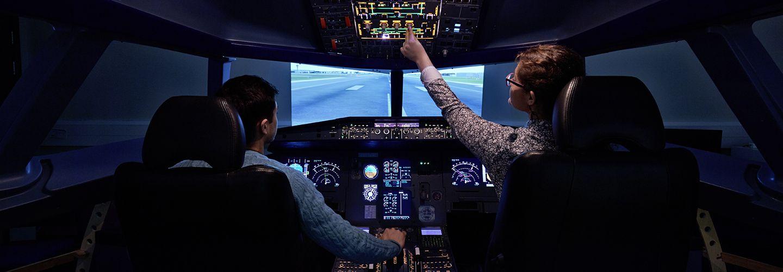 City, University students using the Flight Simulator on campus