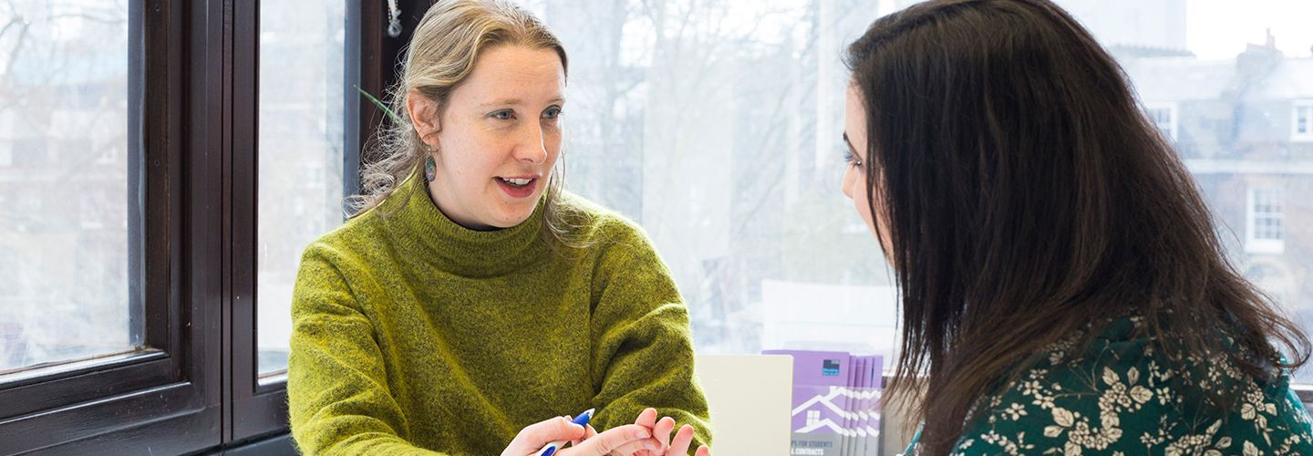 Counsellor talking to a student