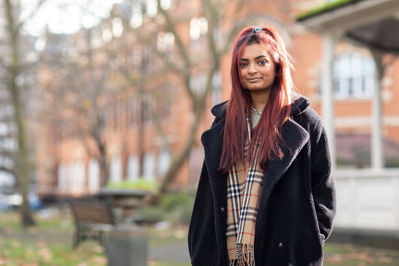 Female student standing outside of City, University of London.