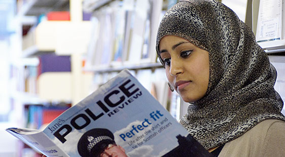 student reading police magazine