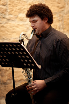 Portrait of George Georgiou playing the saxophone, BMus alumnus and Stage Coordinator for the Cyprus Symphony Orchestra