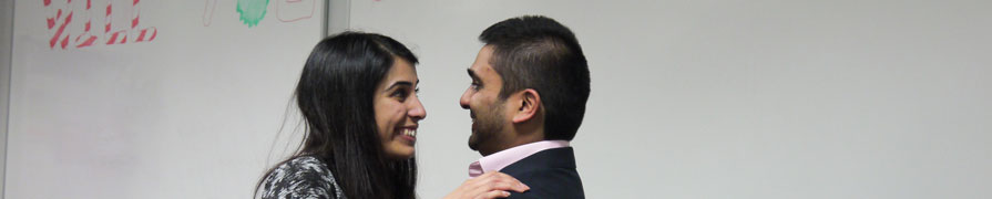Couple embrace after a wedding proposal in a City learning space